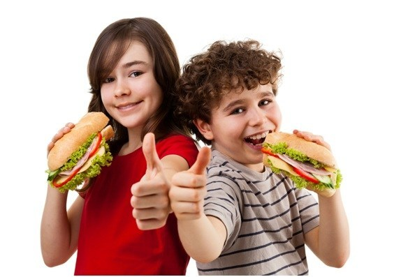 Happy kids eating sandwiches